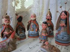 This brings to mind  Debbie C's huge collection of nativity sets.  Christmas Nativity Set Tonala Clay Made In by LeapingFrogDesigns, $35.00