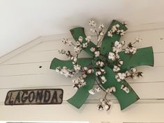 Antique industrial fan blade with cotton at vintage street sign