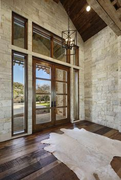 Stone foyer with stone wall and reclaimed ceiling beam for front entrance inspir. Stone foyer with stone wall and reclaimed ceiling beam for front entrance inspiration