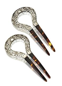 Hair comb pairs like this were also called opera combs. The crowns of these are openwork plaques set with about 1.50 carats of European-cut and rose-cut diamonds atop tortoise shell combs.
