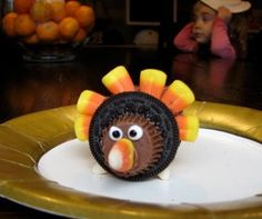 This edible candy corn and Oreo cookie turkey is a fun and easy craft that you can do with your kids.