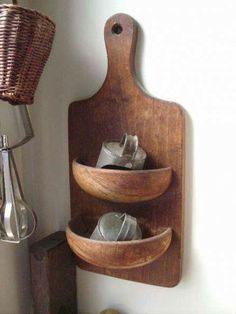 cute idea - could also hold plants or flowers. Cut a wooden bowl in half and glue to a cutting board! Smart!