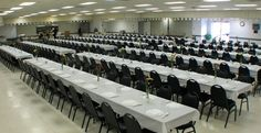 Banquet halls and auditoriums have a kind of empty feel to them before events start. They are vast and spacious. But having people in them seem even bigger. Tables look bigger when you have a person sitting in them for comparison.