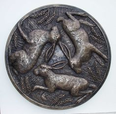 Three hare symbol sculpture is an ancient symbol of three hares or rabbits running in a circle and joined by their ears which form a triangle at the center of the design. The symbol is a puzzle for each creature appears to have two ears yet, between them, there are only three ears.