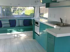 Gorgeous teal and navy blue used to great effect in this contemporary caravan interior.