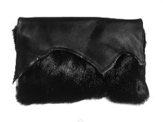 A raw-edged Leather Clutch with hidden magnetic dome closure, and concealed wrist strap option, perfect for evening. Fur Trim, Leather Clutch