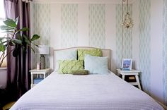 Self-adhesive wallpaper applied in a striped pattern lends some color and visual interest without darkening the room. Interesting...