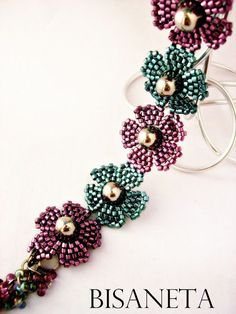 Bisaneta Bracelet. Use a big pearl and colored seed beads 11/0. Brick stitch, and there you have it.