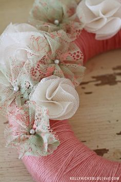 DIY yarn wreath with beautiful vintage lace and chiffon flowers. This blog has a full set of instructions for creating the flowers!