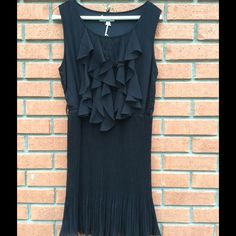 """YA LOS ANGELES SIZE MEDIUM BLACK DRESS..NEW New with tags shelf is 60% silk...40% polyester...lining 100% polyester..size medium..measures 34"""" bust...34"""" length..has belt loops but. I do not have the belt Ya los angeles Dresses"""