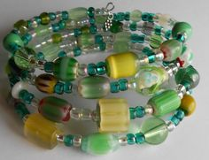 Memory Wire Bracelet: Green and Yellow Lampwork Glass Beads on Oval Wire by VineDesignBeads