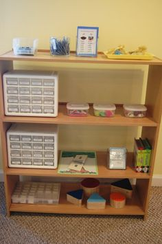 Montessori Elementary Language Shelf - I would incorporate something like this in my classroom to make students who speak different languages more comfortable.