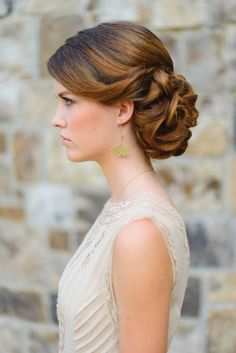 Gorgeous wedding updo. Hair and makeup by Claudia Mejerle. Dress by ASOS, image by Rustic White Photography. Featured in the Fall 2014 issue of Weddings Unveiled.