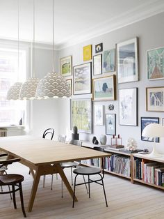 I absolutely love this setting for a creative space and the lampshades over the table.