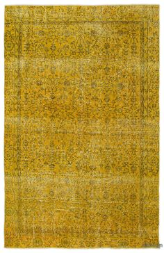 """For a contemporary look with abstract appeal, this yellow over-dyed rug is skillfully crafted by the revitalization of a genuinehand knotted vintage Turkish rug wovenin the 60'sor 70's. Made from wool on cotton, this """"distressed"""" rug measures 187 cm x 295 cm. The process in creating these works of art begins by shearing to lower the pile and to help """"distress"""" them. They then undergo a series of processes to remove the color. They are now ready to be dyed in one color, a stage that can b…"""
