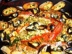 Traditional Italian Grand Fish Feast (Grande Festa di Pesce)   A bounty of fresh fish in a light tomato sauce and crostini for dipping.   Enjoy the feast! An authentic Italian recipe from our kitchen to yours. Buon Appetito!