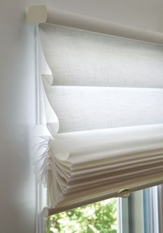 Radiate a sense of comfort and freshness with all white Vignette® Modern Roman Shades with LiteRise® cordless lifting system. ♦ Hunter Douglas window treatments