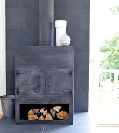 Wood stove, minimal and clean but you can't see the flames. #winter, #design