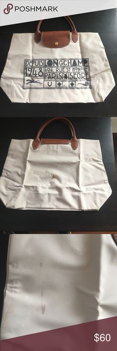 Limited edition Longchamp Le pliage bag Short handles. Embroidered and stamped design on front. Two small stains on back shown up close in photos. In great condition for a white bag. Color is off white Longchamp Bags Satchels