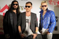 Tomo Milicevic, Shannon Leto and Jared Leto of 30 Seconds To Mars pose on the red carpet at the MTV World Stages on Aug. 25, 2010, in Mexico City.