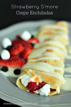 Strawberry S'more Enchiladas with Warm Vanilla Sauce -- crepes filled with strawberries, chocolate and marshmallows, and pan fried until gooey on the inside and crispy on the outside.