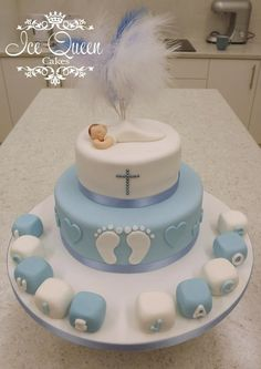 2 tier baby boy christening cake with blocks & feathers. Ice Queen Cakes- St Helens, Liverpool, Manchester