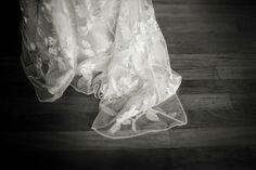 Claire Pettibone's Adagio. Lace train, wooden floor.