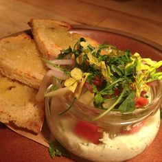 To start: herbed ricotta with pickled ramps, turnip, artichoke & sourdough. #flourandwater