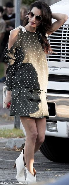 Glamorous: As always, the barrister looked gorgeous in a polka dot top and skirt set...
