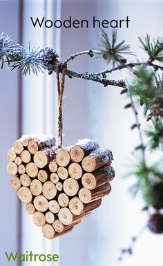 For a simple DIY gift or tree decoration this wooden heart is perfect! Gather together a bundle of small sticks. Saw them into lengths and, using strong wood glue, stick them together in a heart shape. Tap a small nail into the top to tie a piece of st Wooden Christmas Decorations, Christmas Wood Crafts, Christmas Flowers, Natural Christmas, Diy Christmas Ornaments, Rustic Christmas, Tree Decorations, Holiday Crafts, Simple Christmas