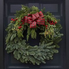 Welcome holiday guests with the sight of a classic wreath and the scent of freshly harvested greens. Farmhouse Christmas Decor, Rustic Christmas, Christmas Crafts, Christmas Movies, Silver Christmas Decorations, Christmas Signs Wood, Fresh Wreath, White Flower Farm, Diy Wreath
