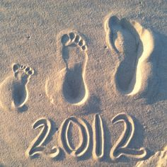 Footprints in sand family photo idea.
