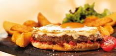 A Patroni Pizza, rede de franquias com 210 unidades em todo o país, aposta em uma novidade para aumentar suas vendas: a pizza de hambúrguer. Ela é vendida ...