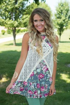 My Secret Garden Tank/Tunic is shabby chic! This floral tunic features a crinkle fabric with sheer ivory lace detailing throughout the center and back with an open back with a one button closure. Floral Tunic, My Secret Garden, Head To Toe, Crinkles, Lace Detail, Shabby Chic, Floral Prints, Ivory, Blouses