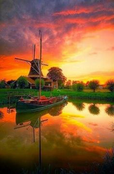 sunset lake reflection windmill boat