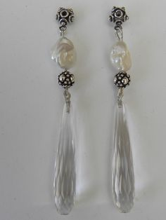 zilveren oorbellen met bergkristal en zoetwaterparels
