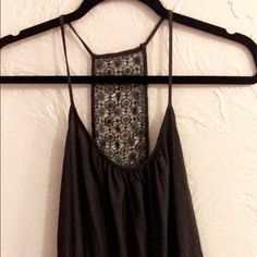 Tank Top. It's a charcoal grey tank with beautiful embroidery back. The waist band fits right but isn't elastic. Express Tops Tank Tops