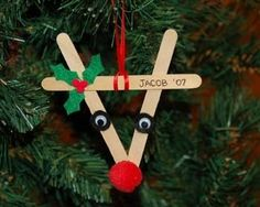 Popsicle stick Rudolph - get rid of the creepy black part around the eyes and move them closer to the nose; could paint the popsicle sticks as well