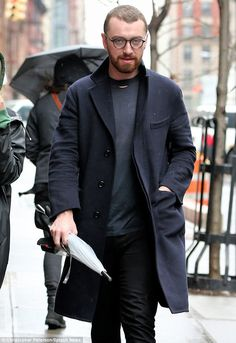 English gent: Sam looked chic in a long navy jacket as he strolled with an umbrella around New York on Tuesday . The singer, is said to be dating British model Jay Camilleri San Smith, Frederick Smith, Singer Sam Smith, Receding Hair Styles, White Umbrella, Uk Singles Chart, Love Sam, Navy Jacket, Billie Eilish