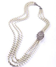 Długi perłowy naszyjnik z kryształową ozdobą