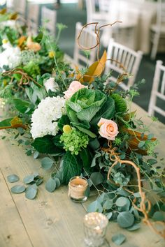 Rustic florals line the center of this wedding table: http://www.stylemepretty.com/2014/12/03/rustic-wisconsin-backyard-wedding/   Photography: Erin Jean - http://www.erinjeanphoto.com/