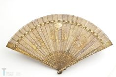 This amazing fan is entirely made of silver filigree. It was probably made in Canton in the mid-19th century and exported to Spain, where it was presented to Queen Victoria Eugenia to complete her traditional attire from Salamanca. (Museo del Traje MT001341).