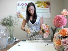 """Blooms By The Box shows you how easy it is to DIY your wedding flowers! This video shows you how to make your own wedding bouquet! It is easy, fun, and rewarding! Order Peach Rose Versilla, Pink Spray Roses, Green Hypericum, 1/2"""" Green Floral Tape, and Ribbon to make this simple wedding bouquet!"""