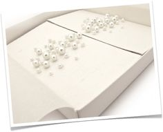 We can add pearls to the outside of the box as well.