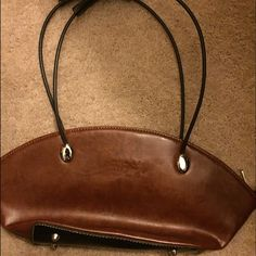 Gucci Wristlet This fabulous GUCCI leather hobo shoulder bag with black handle is TO DIE FOR!! MINT CONDITION!! NEVER USED! This gorgeous GUCCI is made of extremely lightweight and super-durable leather. Doesn't scratch like lambskin or some other leathers. GUCCI – Made in Italy leather tag Gucci Bags Clutches & Wristlets