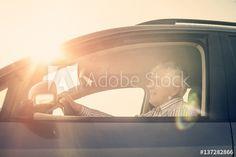 Senior man driving a car.