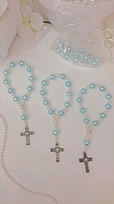 Beautify your special day by giving charming rosary bracelets to your special guest. The bracelets are a perfect way to thank your loved ones for sharing the blessed day with you. It is a keepsake they will have forever and may use often. The bracelets are sold by the dozen or singles. Beautify baptisms, first communions, or give them away to your bridal party as wedding favors. *** Cross Pendants may vary ***