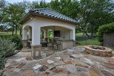 Backyard outdoor living area, covered entertaining gazebo, outside bar, fire pit, golf course lot on #timarron course in #southlake