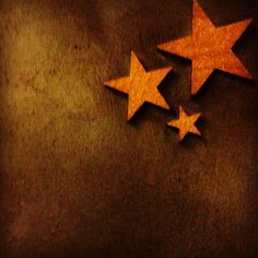 DIY Christmas canvas - painted canvas, wooden stars painted with gold glitter paint and then aged with dark wax