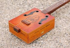 Family Fun: How to Make a Guitar Out of a Cigar Box Basic Guitar Lessons, Acoustic Guitar Lessons, Acoustic Guitar Strings, Acoustic Guitars, Guitar Girl, Guitar Case, Cigar Box Guitar Plans, Bass Guitars For Sale, Cigar Box Crafts